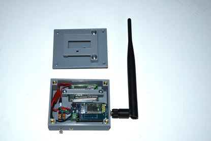 Assembled T3 receiver case with the belt clip lid removed to show case internals (customer supplies T3 receiver, antenna and battery)